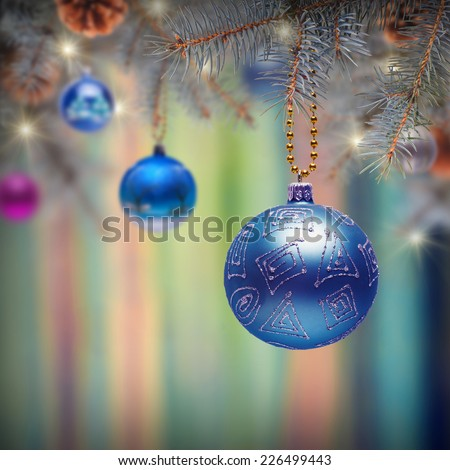 Christmas composition. Fir branches decorated with Christmas toys on blurred nature background - stock photo