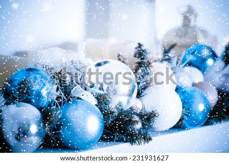 Christmas composition with balls and decoration with snow and star. Blue toned - stock photo