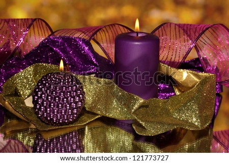 Christmas composition  with candles and decorations in purple and gold colors - stock photo