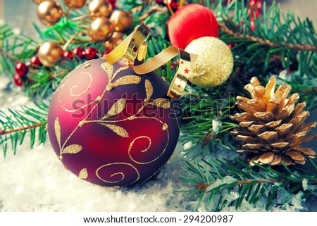 Christmas composition with christmas ball and decoration. Selective focus. Retro style toned. - stock photo