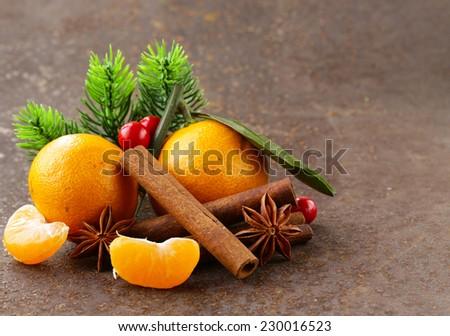 Christmas composition with fresh mandarin oranges, cinnamon, anise - stock photo