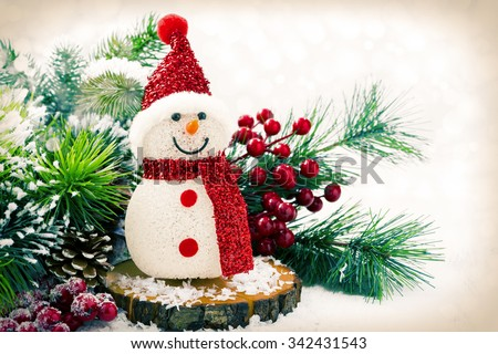 Christmas composition with snowman and fir branches in vintage style, horizontal - stock photo