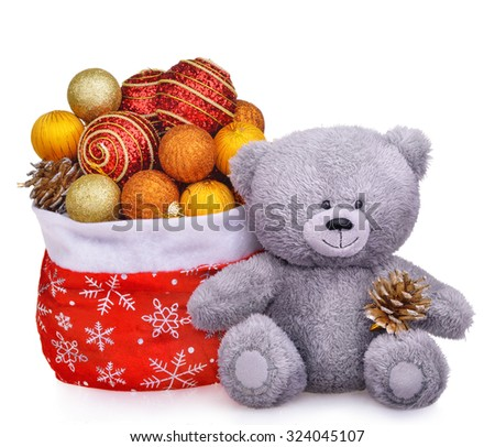 Christmas composition with teddy bear and santa claus bag full of toys isolated over white background - stock photo