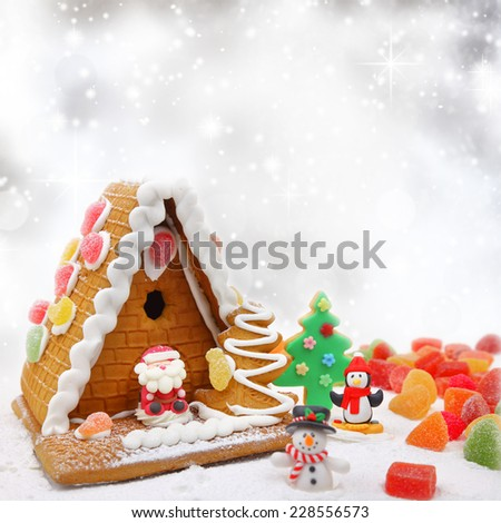 Christmas cookie house with festive decoration and bokeh background - stock photo