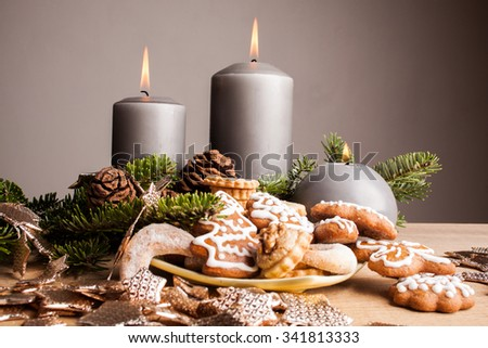 Christmas cookies and candles on wooden table - stock photo