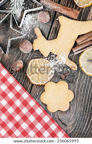 Christmas cookies and different ingredients for baking - stock photo