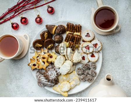 Christmas cookies and fresh tea, showy, plate and background - stock photo
