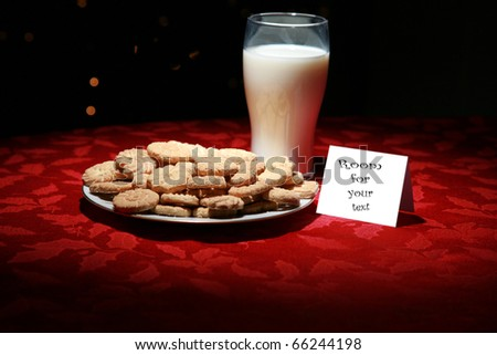 christmas cookies and milk for santa claus on christmas eve - stock photo
