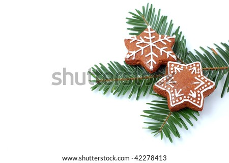 Christmas cookies (gingerbread) on green branch - stock photo