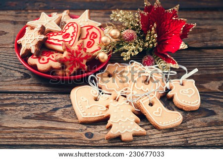 Christmas cookies handmade lies on wooden background. Gingerbread reindeer cookies and christmas decoration  Christmas tree - stock photo