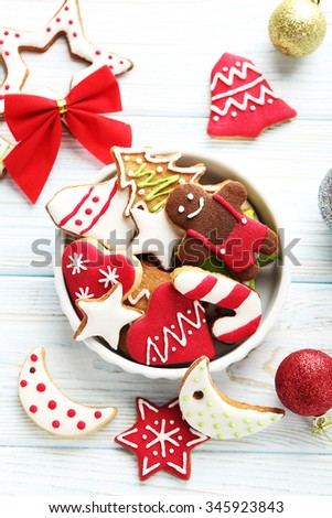 Christmas cookies in bowl on a blue wooden table - stock photo