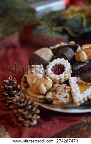 Christmas cookies on a plate with Christmas decoration. - stock photo
