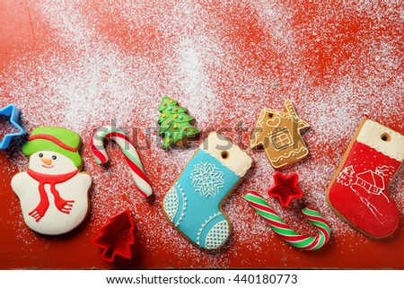 christmas cookies on red background, holiday food - stock photo