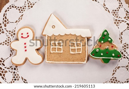 Christmas cookies on wooden table - shallow DOF. - stock photo