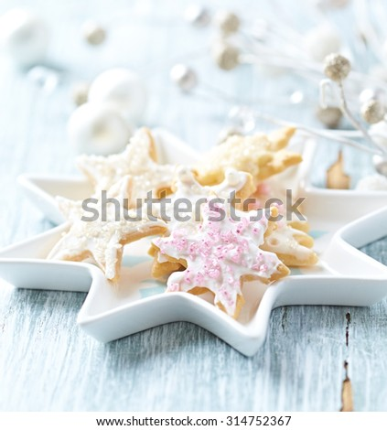 Christmas cookies with icing and sugar pearls  - stock photo