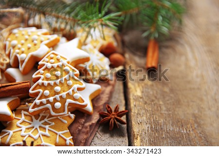 Christmas cookies with spices on wooden table - stock photo