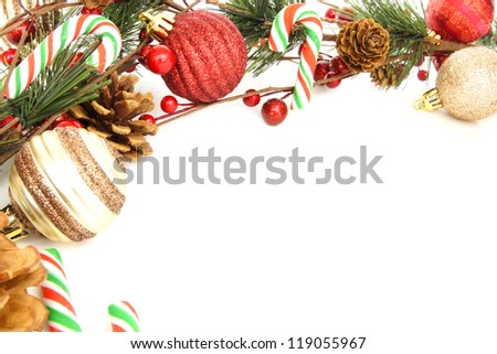 Christmas corner border with baubles, tree branches and candy canes over white - stock photo