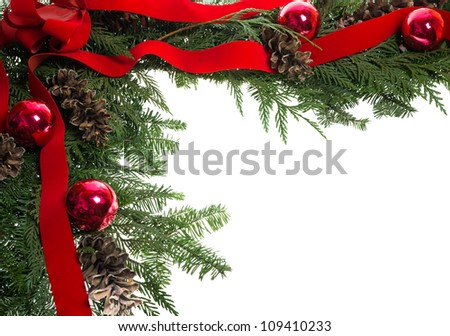 Christmas corner border with red bow and pine cones - stock photo