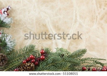 Christmas corner frame with fir branch, icy foliage, holly berries on antique paper with copyspace - stock photo