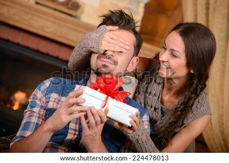 Christmas Couple. Happy Smiling Family at home celebrating. New Year People - stock photo