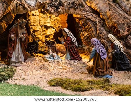 Christmas creche with women worshiping god - stock photo