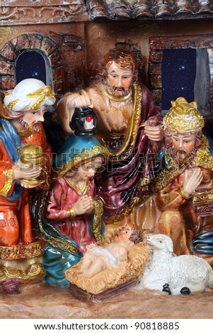 Christmas Crib. Nativity scene with the holy family and Jesus in the manger. - stock photo