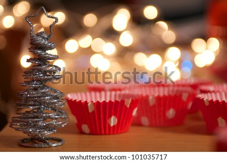 Christmas Cupcake Holders with sparkly Christmas Tree and fairy lights - stock photo