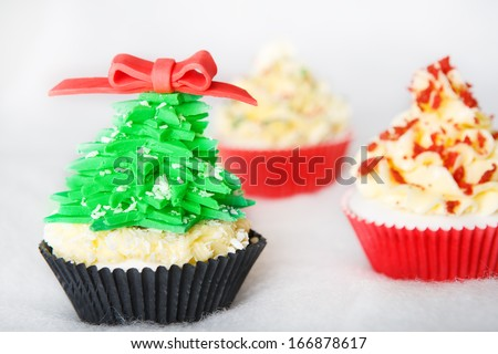 Christmas cupcake with white fondant - stock photo