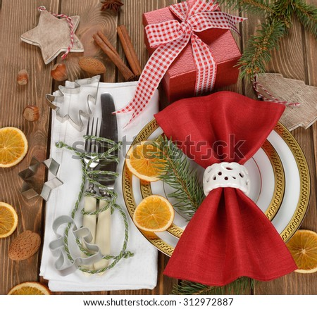 Christmas cutlery on a brown background - stock photo