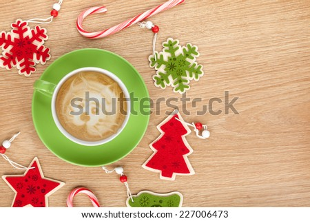 Christmas decor and coffee cup over wooden table background with copy space - stock photo
