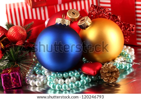 Christmas decoration and gift boxes on gray background - stock photo