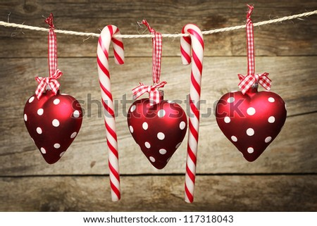 Christmas decoration and hearts Hanging on a Rope - stock photo