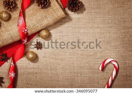 Christmas decoration background over linen background. Horizontal photo taken from above, top view with copy space for text and other web or print design elements. - stock photo
