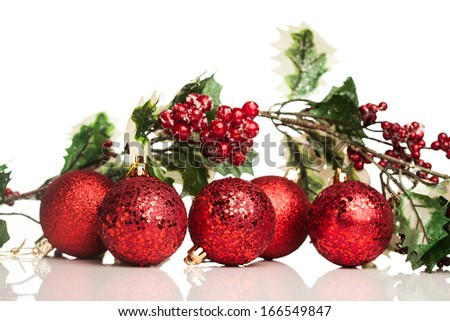Christmas decoration ball with european holly - stock photo