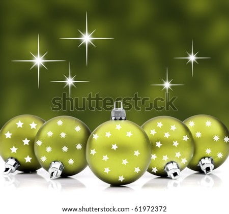 Christmas decoration balls against a star background - stock photo