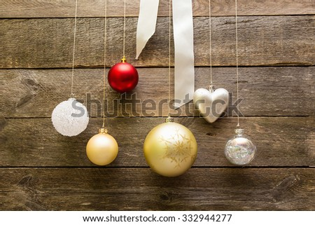 Christmas decoration balls hanging on a wooden wall - stock photo