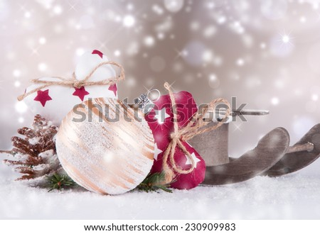 Christmas decoration, balls , sledge and textile hearts on snow with abstract background  - stock photo