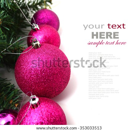 Christmas decoration (branch of spruce tree, pink baubles) on the wooden background with copy space - stock photo
