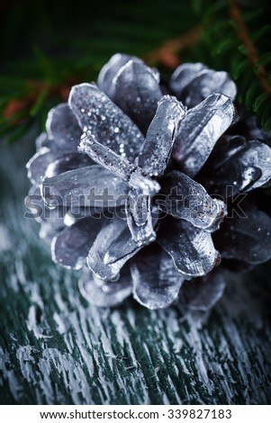 Christmas decoration card with evergreen fir tree, cones, Selective focus, shallow dof - stock photo