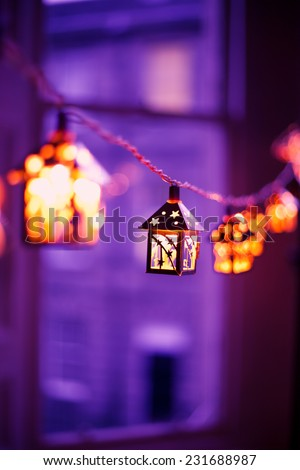 Christmas decoration. Colorful window in the city during winter.  - stock photo