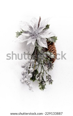 christmas decoration festive bound with pinecone on white - stock photo