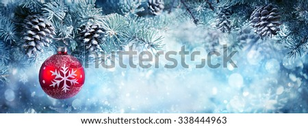 Christmas Decoration For Banner - Red Bauble Hanging Fir Branch - stock photo
