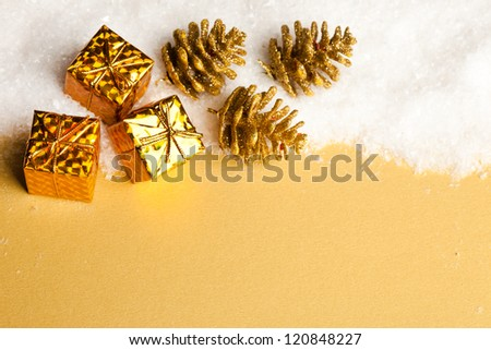Christmas decoration gift boxes with pinecone and snow - stock photo