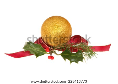 Christmas decoration, gold bauble with holly, pine needles and a red ribbon isolated against white - stock photo