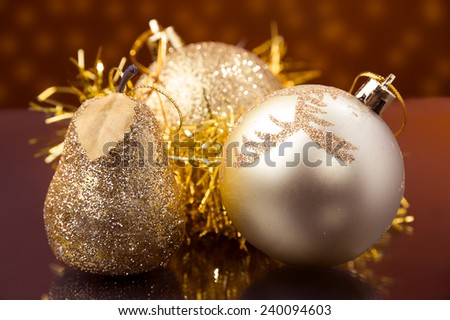 Christmas decoration gold pear,gold ball and shiny gold bald close up  - stock photo
