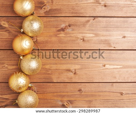 Christmas decoration golden balls over the wooden background as a festive copyspace composition - stock photo