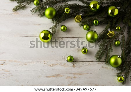 Christmas decoration green balls, fir branches on a white wooden background, copy space, Christmas decoration, Christmas ornament, Merry Christmas  - stock photo