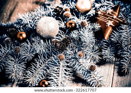 christmas decoration - green branch on the wooden floor - stock photo