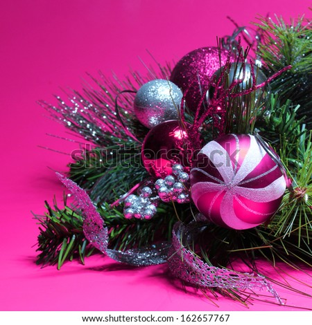 Christmas Decoration. Hot Pink and Silver Balls on Christmas tree branch over magenta background. Holiday Card - stock photo