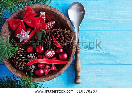 christmas decoration in a wooden bowl on a blue wooden background. christmas motifs. top view. - stock photo